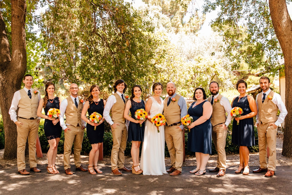 Tan Groomsmen Suits with Navy Bridesmaid Dresses
