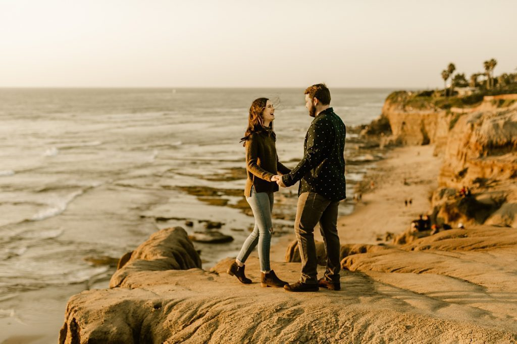 Candid engagement photos san diego photographer