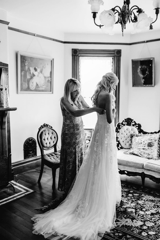 bride's mom helping her get ready in bridal suite, Portland wedding photos