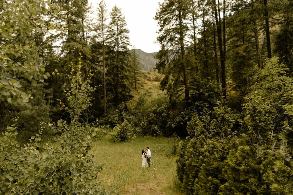 elope in the mountains, first dance in open field surrounded by nature, wedding photographer