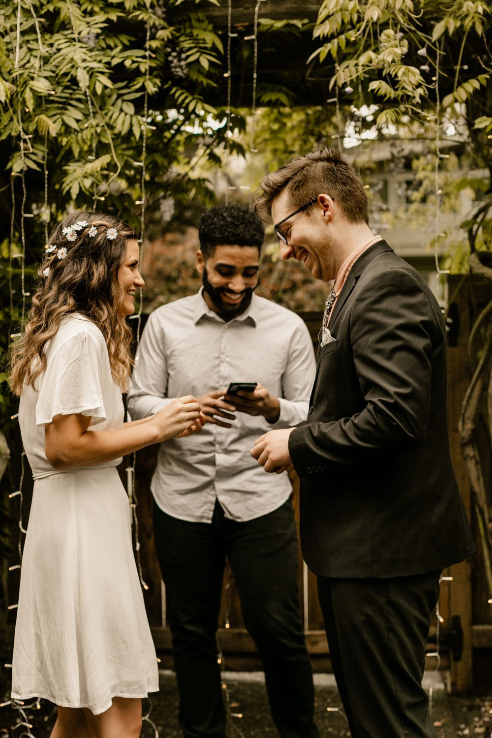 candid moments exchanging rings ceremony