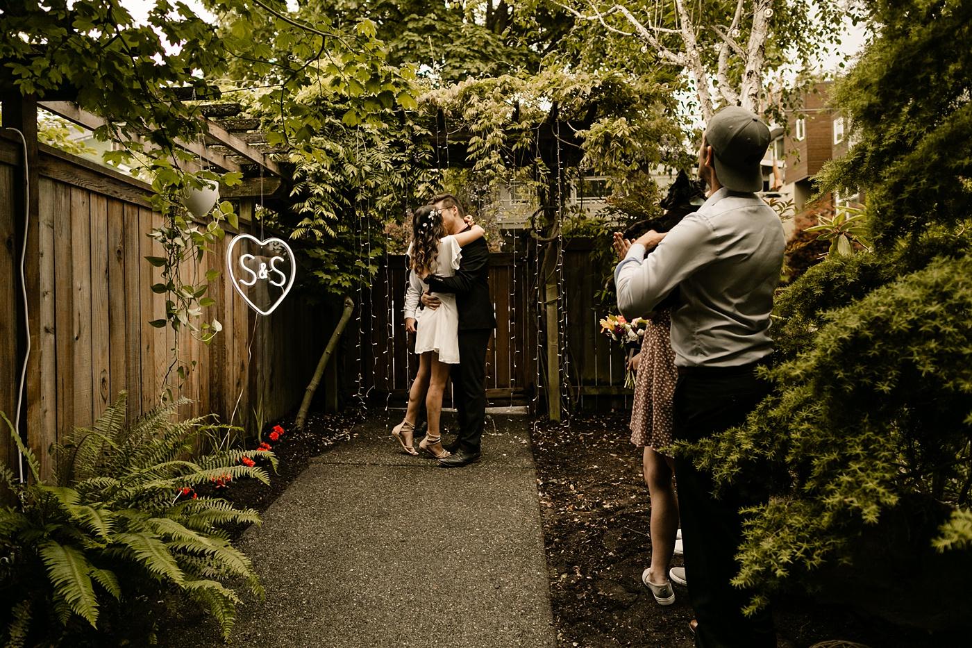 first kiss wedding ceremony social distanced backyard wedding