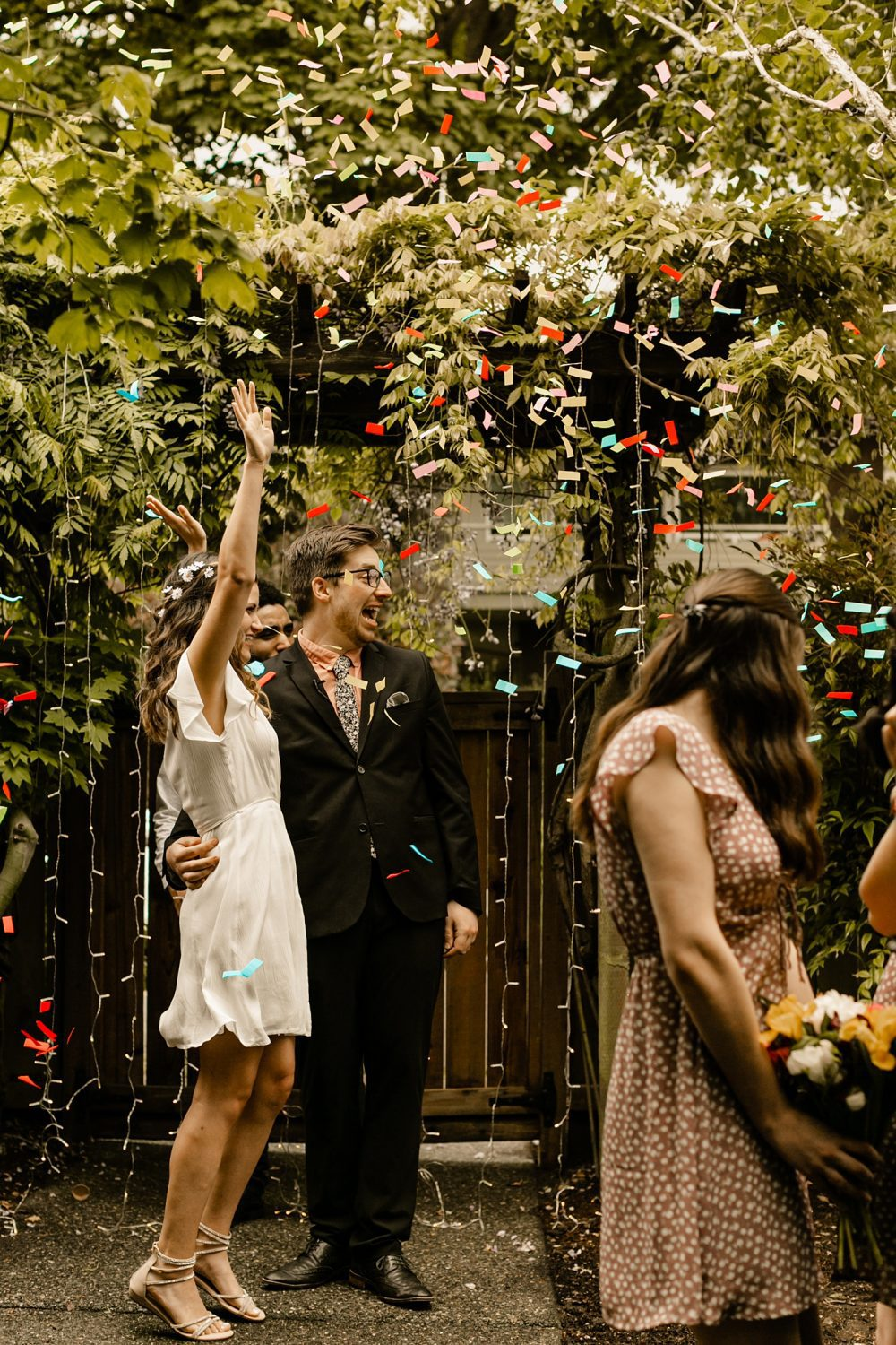 confetti after first kiss for front yard wedding