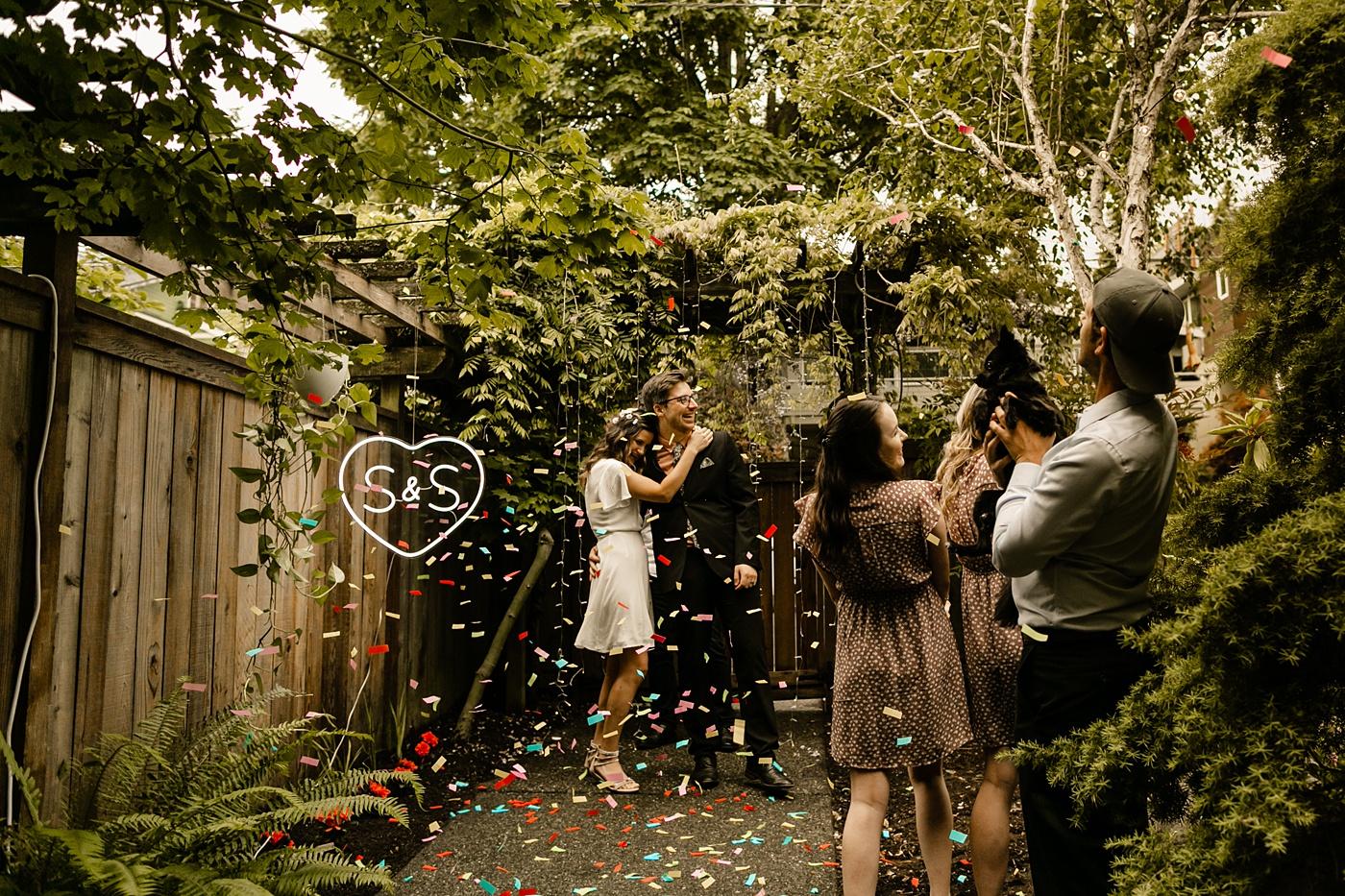 confetti during backyard elopement wedding ceremony
