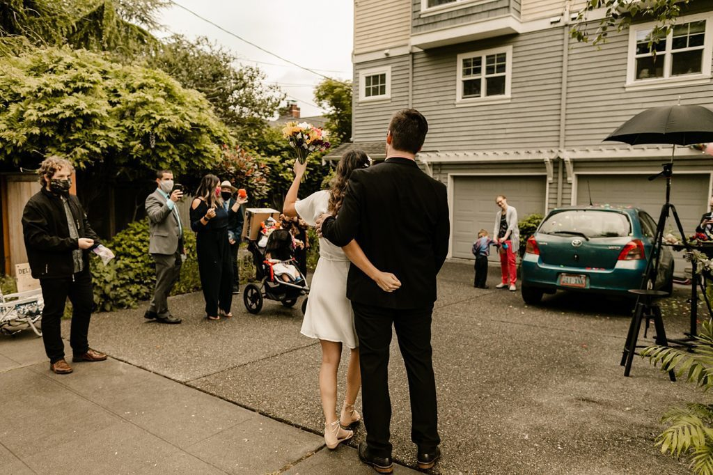 first dance in your drive way, social distancing guests, bride and groom elopement