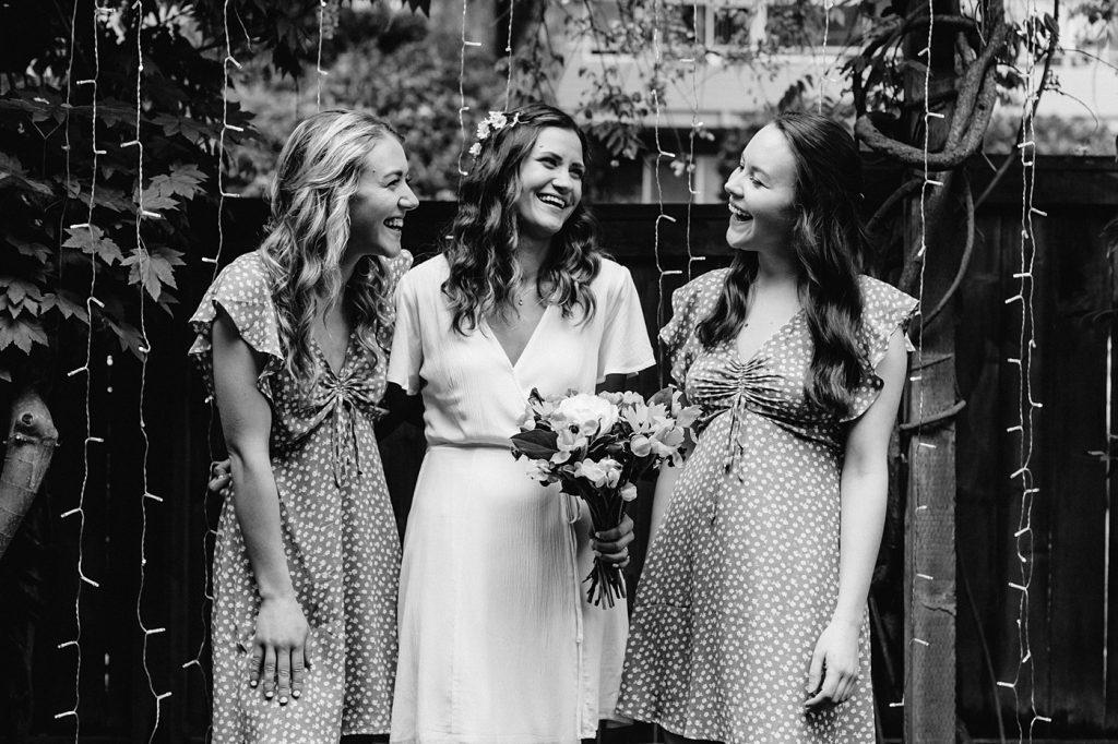 bride with her bridesmaids backyard elopement
