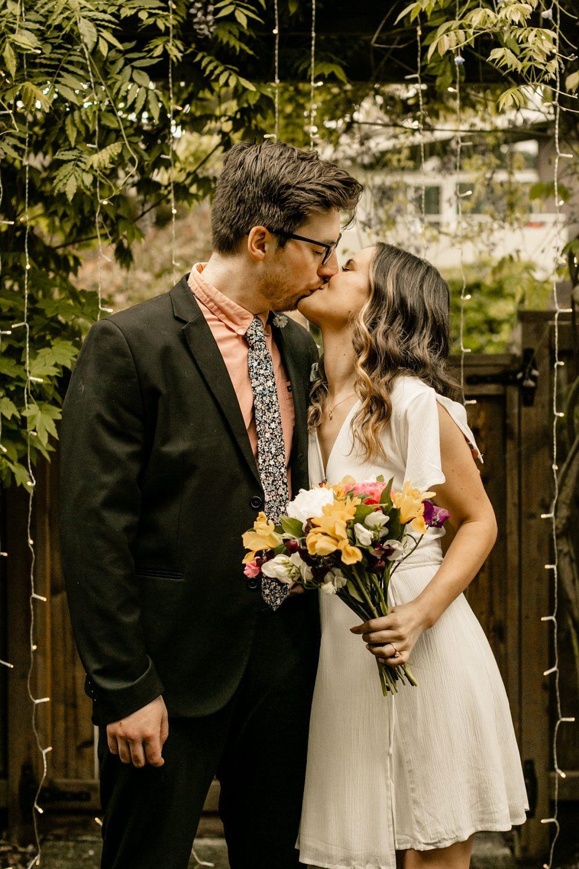 elopement style dress, pink floral black groom suit, pike place flower bouquet