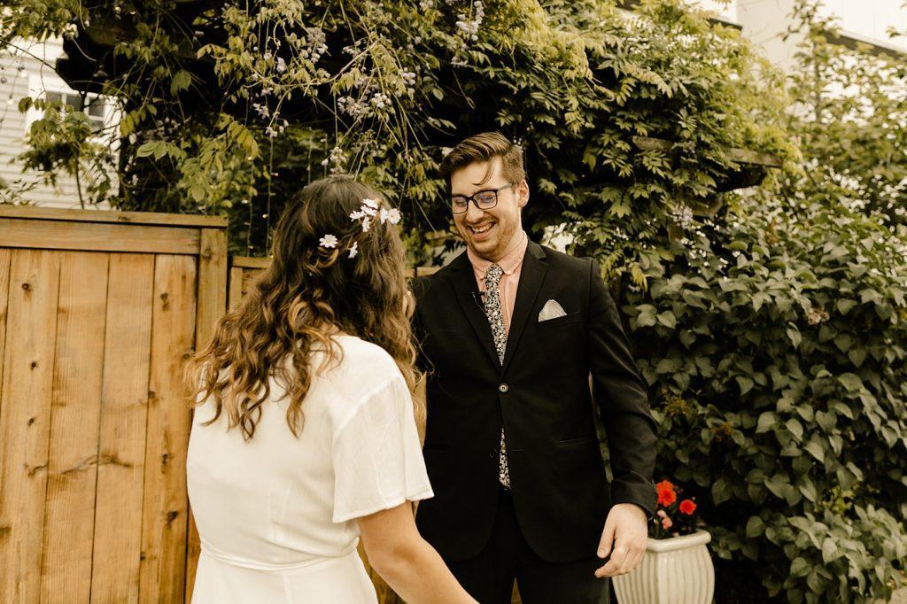 groom floral tie pink shirt black suit