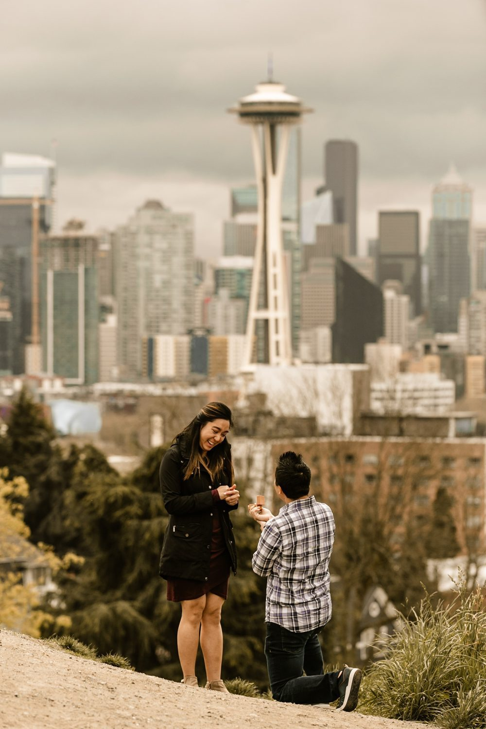proposal with the seattle city skyline and the space needle