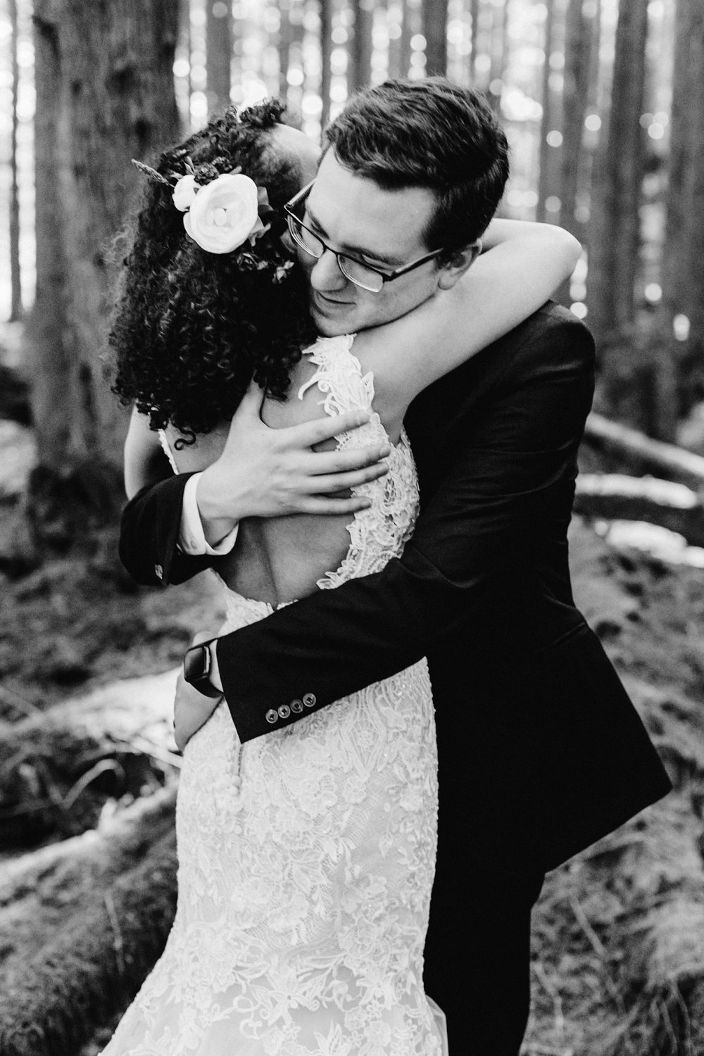 How To Choose The Best Wedding Vendors, emerald forest elopement venue in the woods, tminspired photography, groom hugging bride, big embrace, black and white photo, sweet pose ideas
