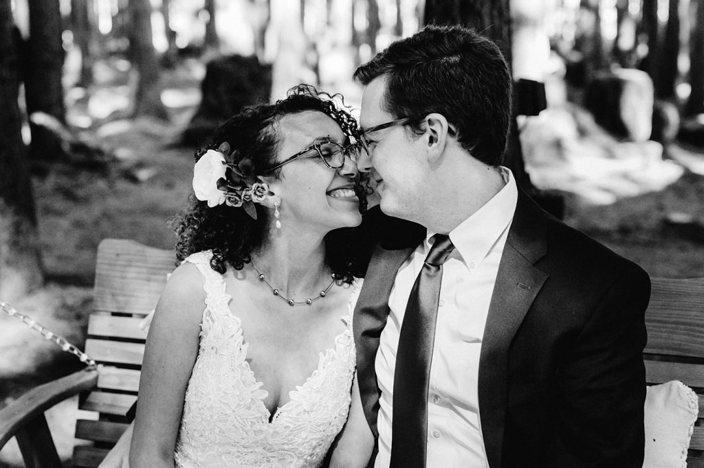 pose idea nose kisses rubbing noses black and white photo bride and groom emerald forest wedding photographer
