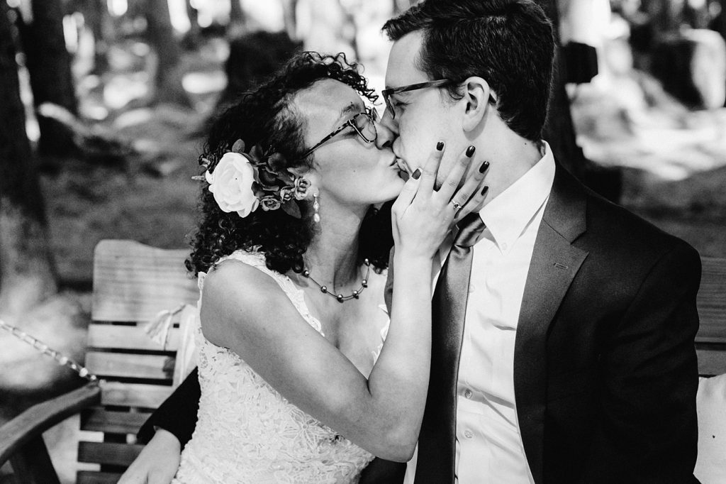 bride and groom wedding day posing ideas tips bride holding grooms face for a kiss, flowers in brides hair seattle photographer