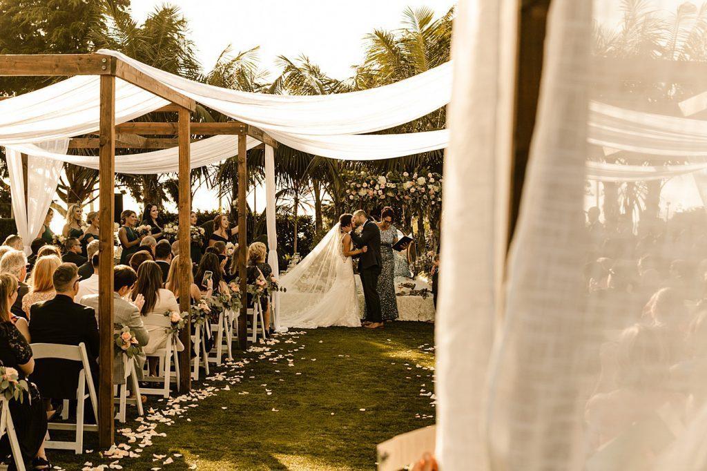 Cape Rey Carlsbad Wedding Photographer ceremony first kiss
