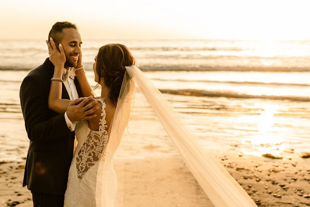 Golden hour sunset photos bride and groom with veil