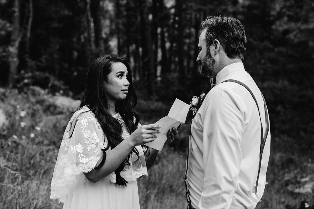 bride reading personal vows candid wedding photographer