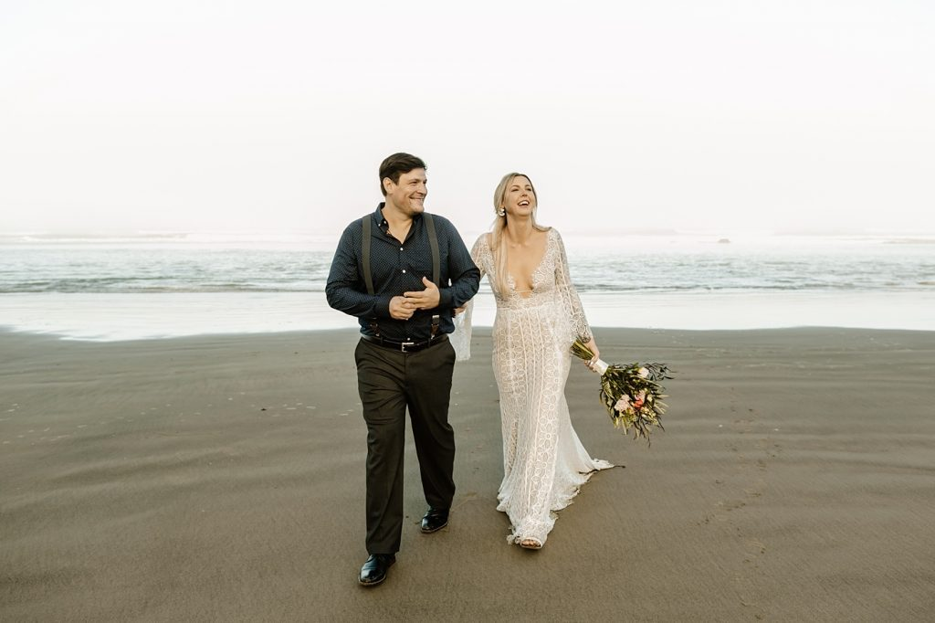 elopement day ideas walk along the coast together at sunrise