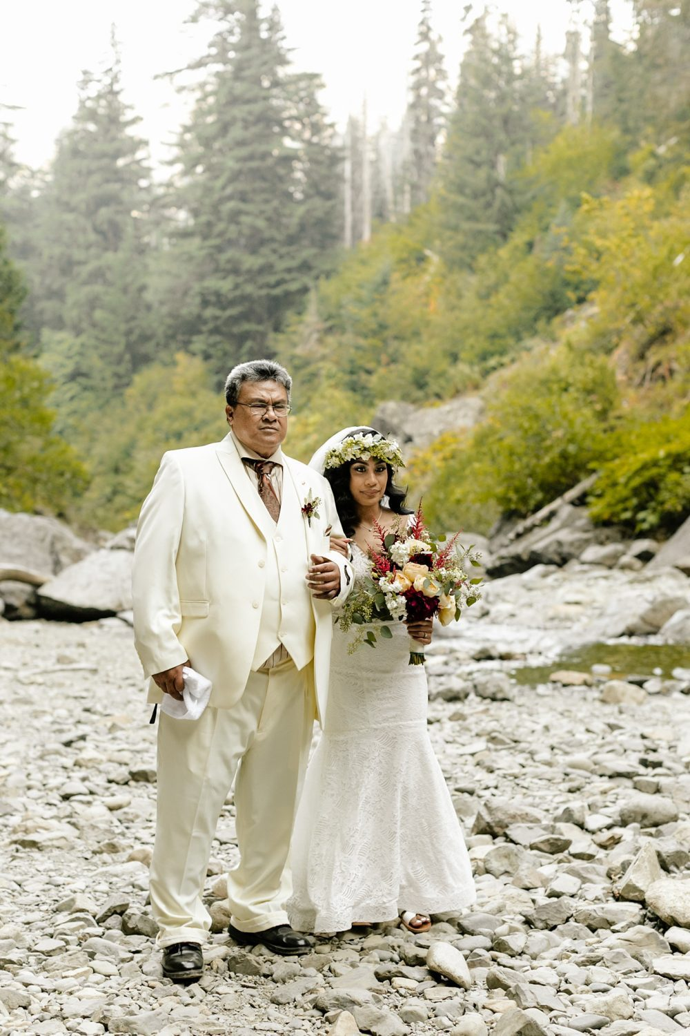 bride walking down aisle with dad white suit