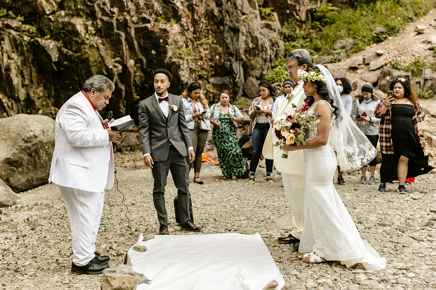 intimate ceremony at the base of a waterfall in the PNW