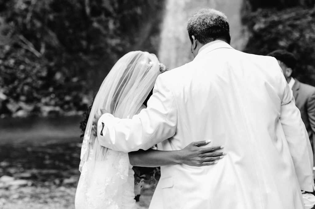 dad giving away bride to her groom, documentary style wedding photographer moments