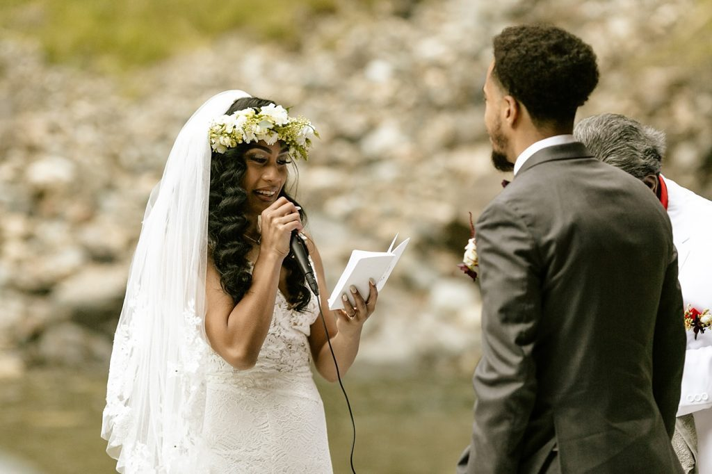 bride reading vows to groom, flower crown with veil
