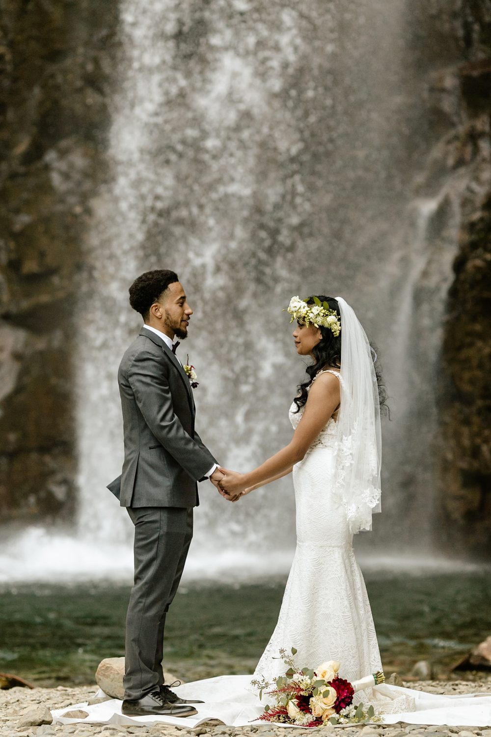 Waterfall elopement bride and groom secluded locations
