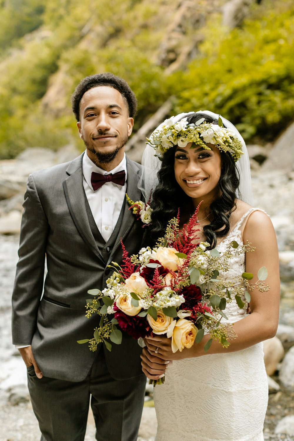 bride and groom together maroon bowtie grey suit