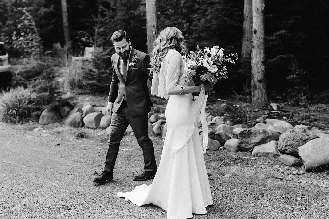 candid wedding photographer groom sees bride for first time