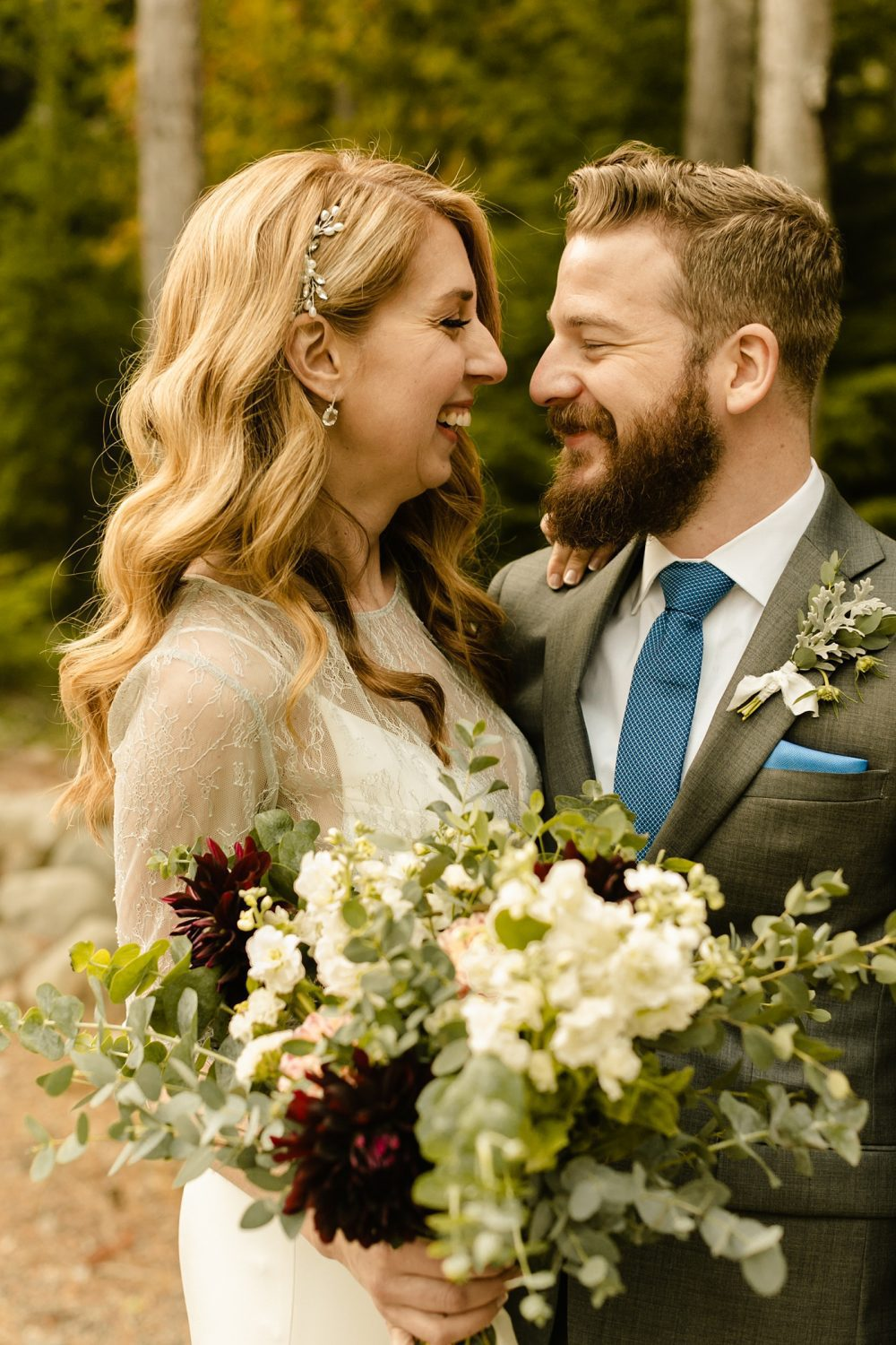candid wedding photographer bride and groom portraits bouquet wildflower
