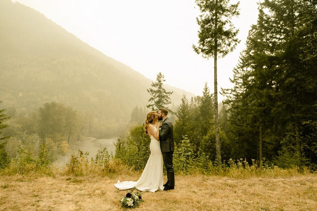 wedding ceremony overlooking river in the washington mountains
